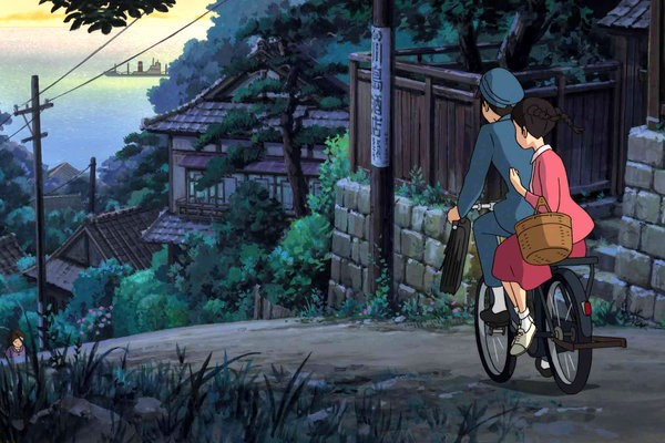 Screencap from Studio Ghibli's  From Up on Poppy Hill. The two leads ride a bike toward a path full of lush greenery and old buildings